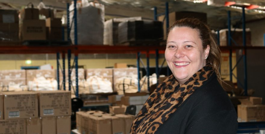 Learning & assessment manager for supported employees Athena from OCC Enterprises smiling in warehouse