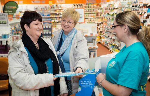 day support program participant buying medicine at the pharmacy