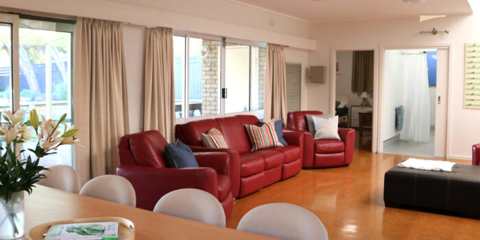 tootgarook accessible family holiday house second loungeroom with red 3 seater couch and 2 one seaters