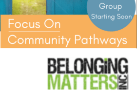 Belonging Matters logo in front of a door and sign that reads Focus on Community Pathways